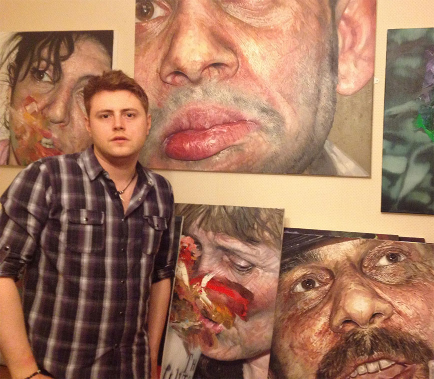 Andrew-with-some-of-his-paintings