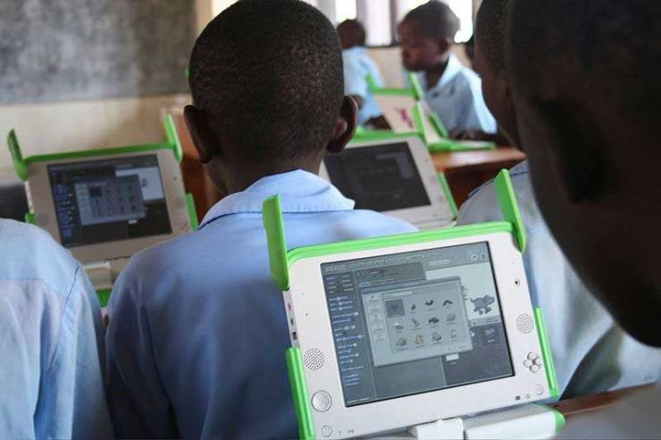 Students in a primary school in Kigali, Rwanda in 2009, with laptops provided by One Laptop per Child.