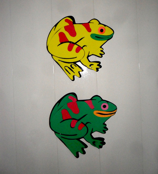 Kids foam rubber frogs on my bathroom door
