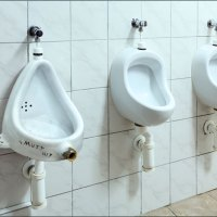 """Artist exhibits Duchamp's """"Fountain"""" in restroom to take the museum out of art."""
