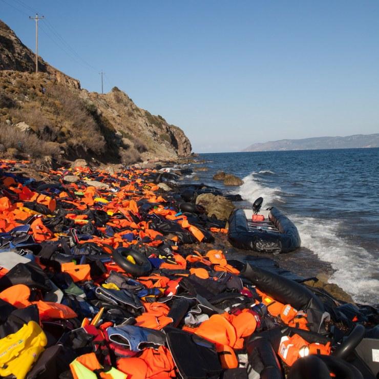 Refugee boat with vests on Lesbos