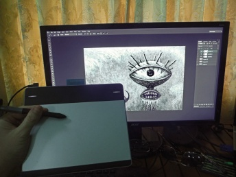 My drawing tablet, stylus, and a drawing on the monitor I made with them.
