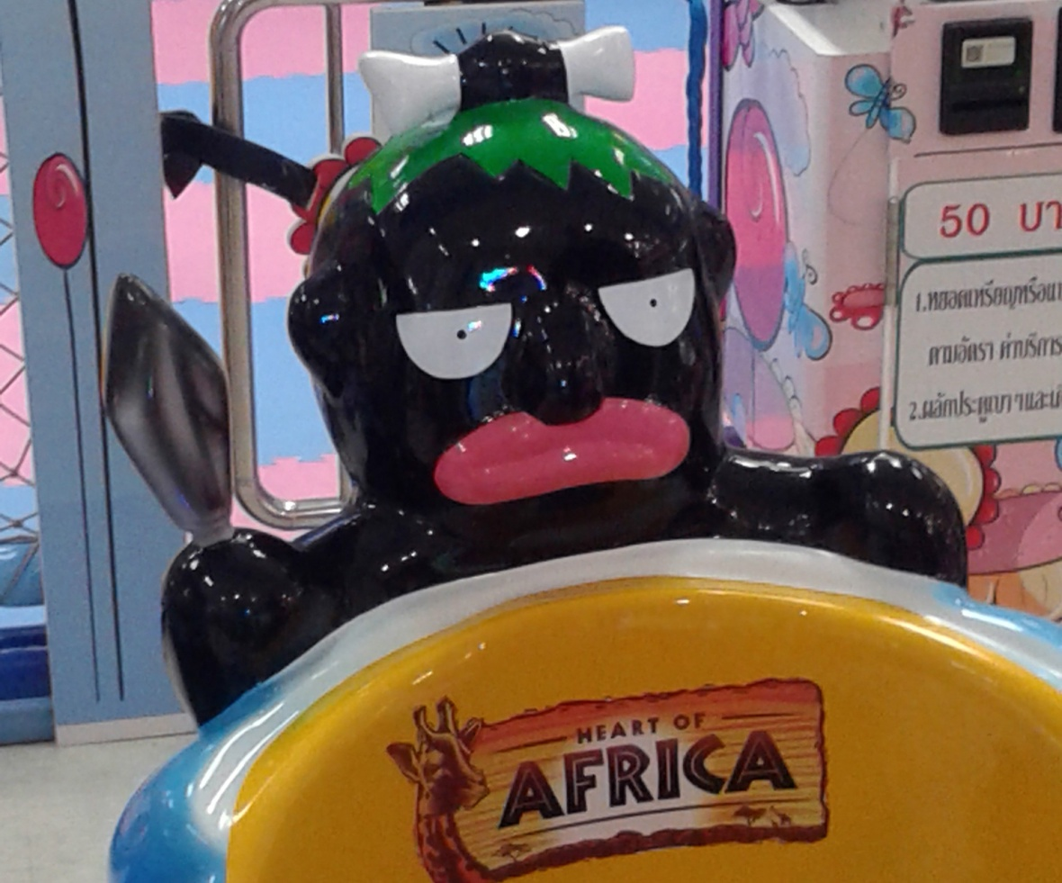 Racist depiction of black male, Africa ride
